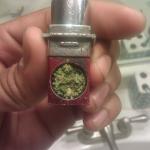 blue dream marijuana in a lip stick pipe